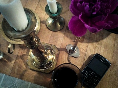 still life with cabernet, peonies, candles and blackberry