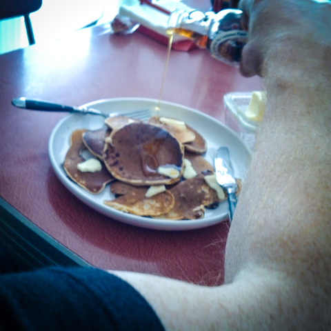 lockman place maple syrup on wild blueberry and chocolate chip pancakes. mmmmmmm.