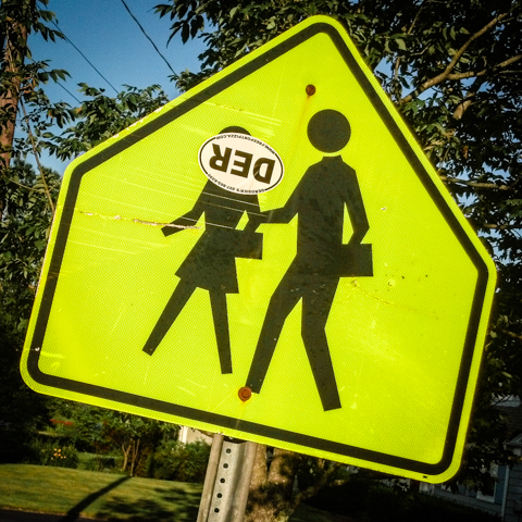 sign of sardonic students crossing