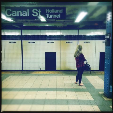 she stands along on her platform
