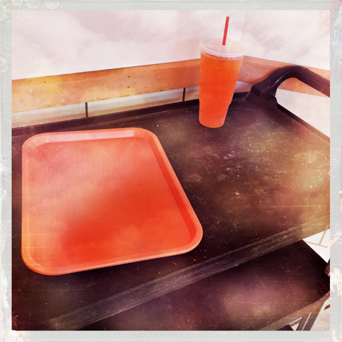 """""""now for a limited time, purchase a large soft drink - get a matching empty tray, at no additional cost..."""""""